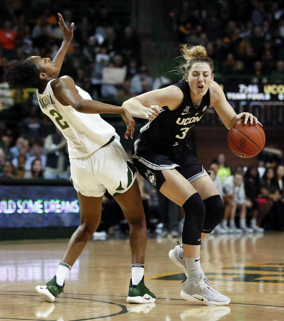 UConn's Katie Lou Samuelson (33) is fouled by Baylor's Didi Richards (2) during Thursday night's game in Waco, Texas.
