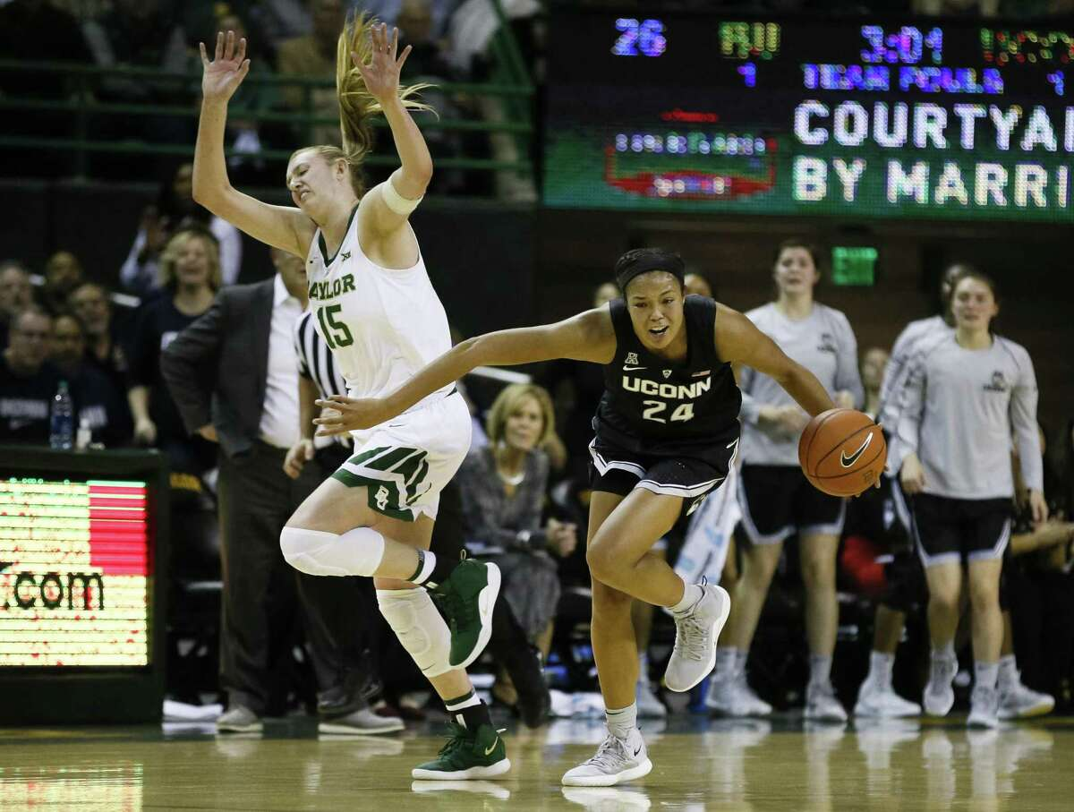 UConn's Napheesa Collier (24) beats Baylor's Lauren Cox (15) to a loose ball during Thursday night's game in Waco, Texas.