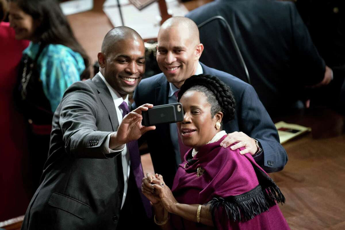 From left, Reps. Antonio Delgado (D-N.Y.), Hakeem Jeffries (D-N.Y.) and Sheila Jackson Lee (D-Texas) pose for a photo in the House Chamber of the Capitol on Thursday, Jan. 3, 2019. Right on schedule, the House gaveled in for the 116th Congress, with Democrats now in control. (Erin Schaff/The New York Times)