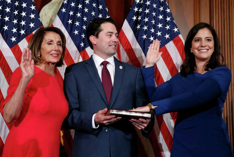 House Speaker Nancy Pelosi of Calif., left, poses during a ceremonial swearing-in with Rep. Elise Stefanik, R-N.Y., right, on Capitol Hill, Thursday, Jan. 3, 2019 in Washington during the opening session of the 116th Congress.. (AP Photo/Alex Brandon)