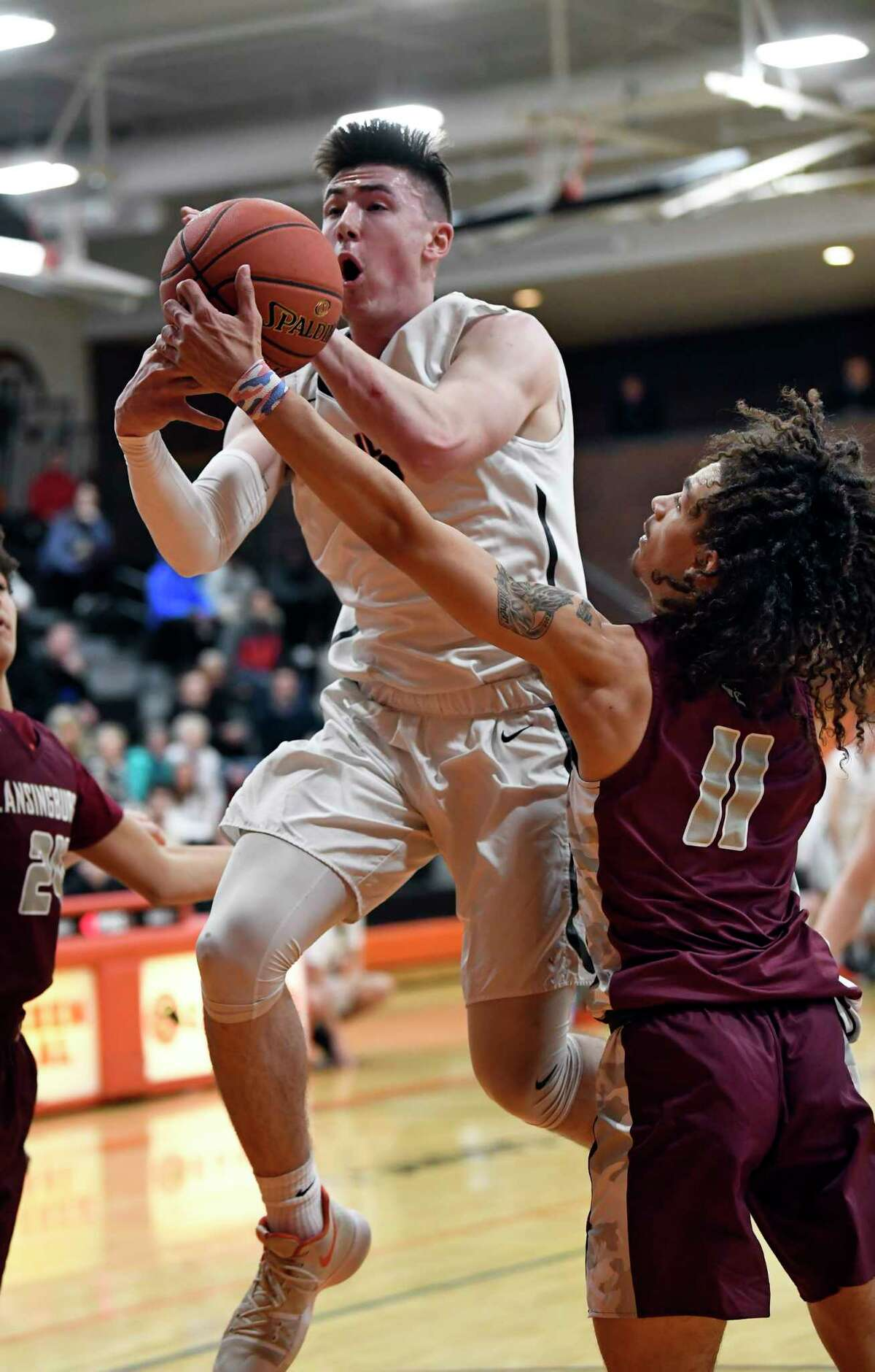 Bethlehem's Michael Ortale ,left, is defended by Lansingburgh's Trevor Green (11) during the first half of a boys high school basketball game Thursday, Jan. 3, 2019, in Delmar, N.Y. (Hans Pennink / Special to the Times Union)