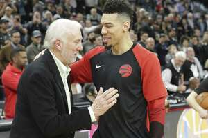 Danny Green gets a pat from his old coach Gregg Popovich as the Spurs host the Raptors at the AT&T Center on January 3, 2019.