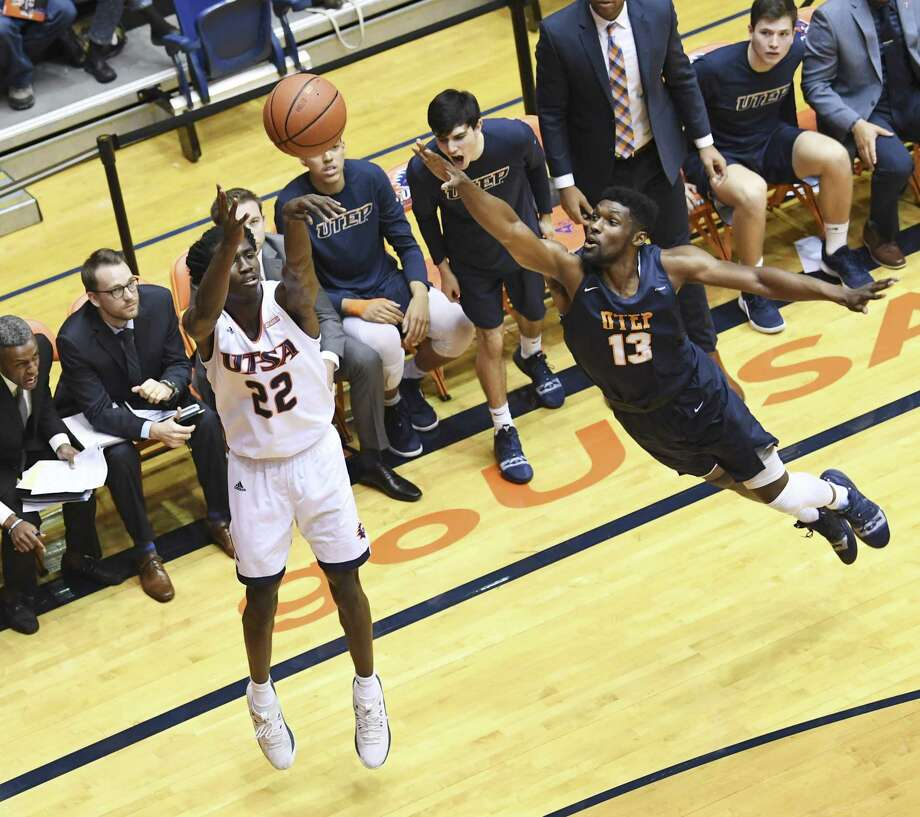 UTSA's Keaton Wallace (22) shoots and scores three as Ountae Campbell (13) and the UTEP bench attempt to defend during college basketball action at the UTSA Convocation Center on Thursday, Jan. 3, 2019. Photo: Billy Calzada, Staff / Staff Photographer / San Antonio Express-News