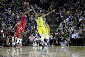 Andre Iguodala (9) defends against a shot by James Harden (13) in the first half as the Golden State Warriors played the Houston Rockets at Oracle Arena in Oakland, Calif., on Thursday, January 3, 2019.