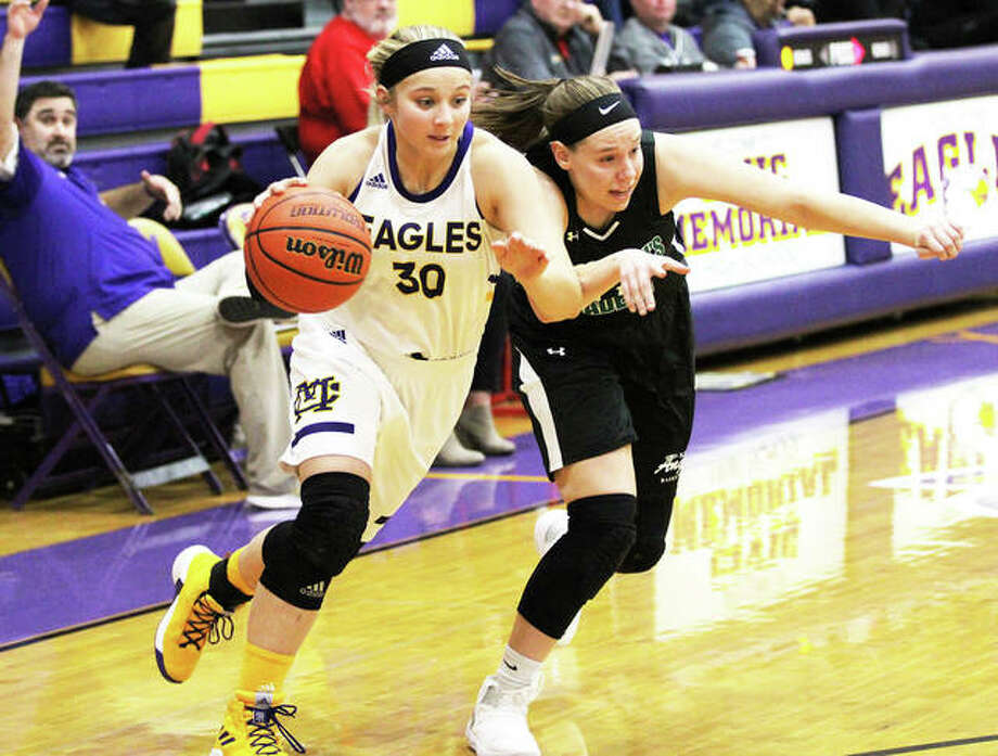 CM's Jenna Chriisteson (left) drives on St. Joe's Sarah Stewart during the second half of an Eagles victory Dec. 15 in the CM/Adidas Shootout in Bethalto. The Eagles have another shootout date Saturday against O'Fallon at Breese Central. Photo: Greg Shashack / The Telegraph