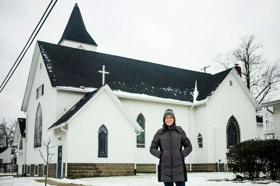 Caregiving Network Executive Director Lorna Gay in front of the 150-year-old chapel building at the corner of Gordon and W. Grove Streets, owned by Caregiving Network. Daily News file photo