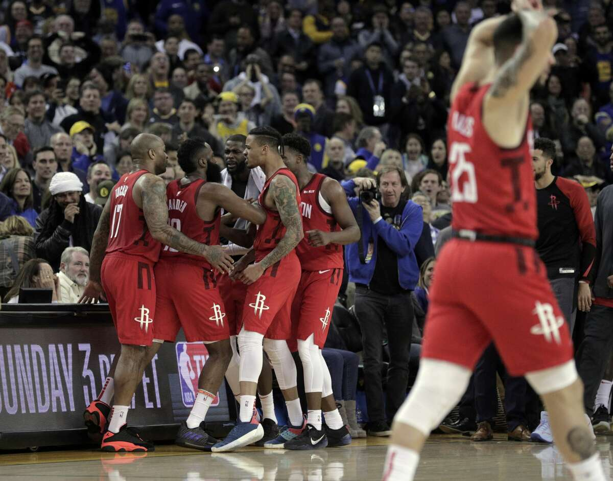 The Rockets celebrate after James Harden (13) hit a three pointer with one second left to give the Rockets the lead in the overtime period as the Golden State Warriors played the Houston Rockets at Oracle Arena in Oakland, Calif., on Thursday, January 3, 2019. The Rockets defeated the Warriors 135-134.