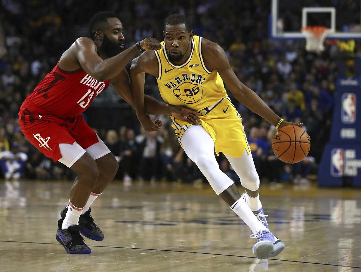 Houston Rockets' James Harden, left, guards Golden State Warriors' Kevin Durant during the second half of an NBA basketball game Thursday, Jan. 3, 2019, in Oakland, Calif. (AP Photo/Ben Margot)