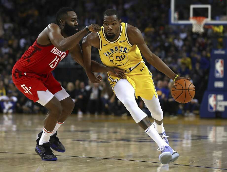 Houston Rockets' James Harden, left, guards Golden State Warriors' Kevin Durant during the second half of an NBA basketball game Thursday, Jan. 3, 2019, in Oakland, Calif. (AP Photo/Ben Margot) Photo: Ben Margot/Associated Press