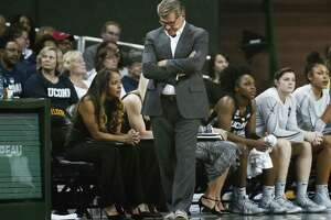 UConn coach Geno Auriemma walks in front of the bench during the first half against Baylor on Thursday in Waco, Texas. Baylor defeated No. 1 UConn 68-57.