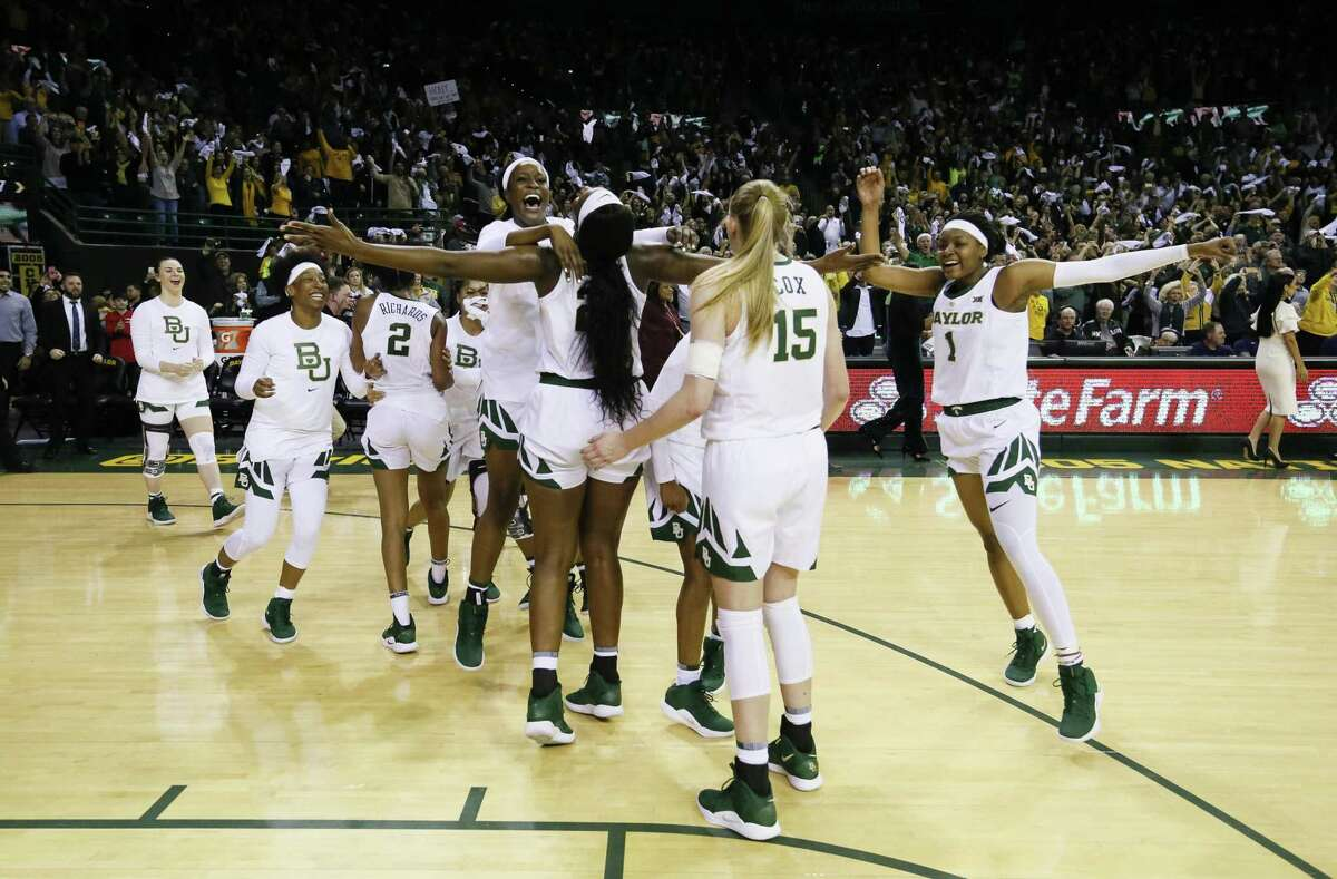 Baylor players celebrate after a 68-57 victory over No. 1 UConn Thursday in Waco, Texas.