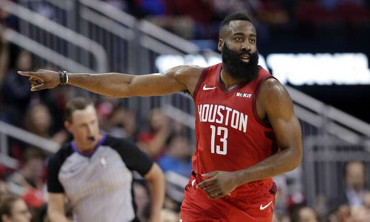Houston Rockets guard James Harden (13) reacts after scoring against the Memphis Grizzlies during the first half of an NBA basketball game Monday, Dec. 31, 2018, in Houston. (AP Photo/Michael Wyke)