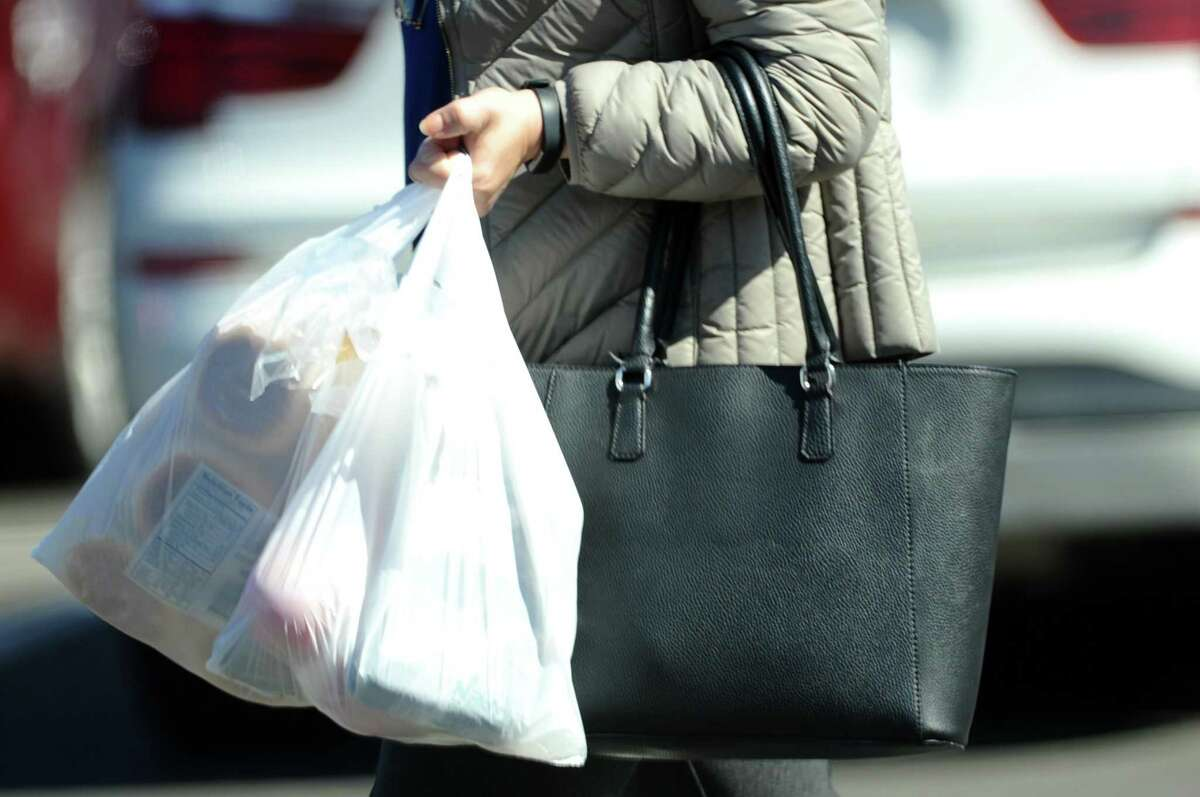 Customers exit Acme with plastic bags on High Ridge Road in Stamford.