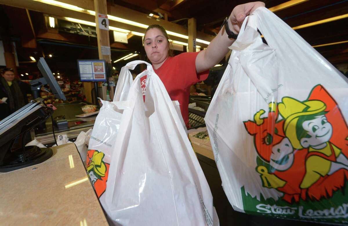 Cashier Caren Montero bags groceries with the Stew Leonard's iconic plastic bags at the Norwalk store.