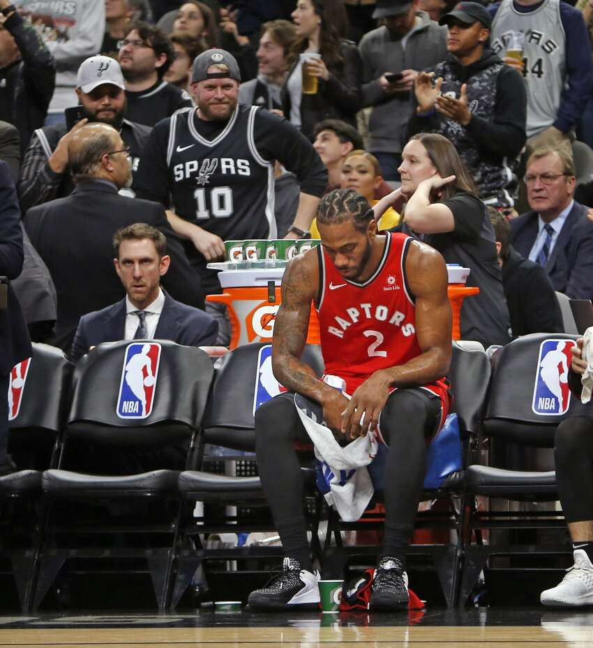 Kawhi Leonard #2 of the Toronto Raptors sits on the bench during a time-out against the San Antonio Spurs at AT&T Center on January 3, 2019 in San Antonio, Texas.