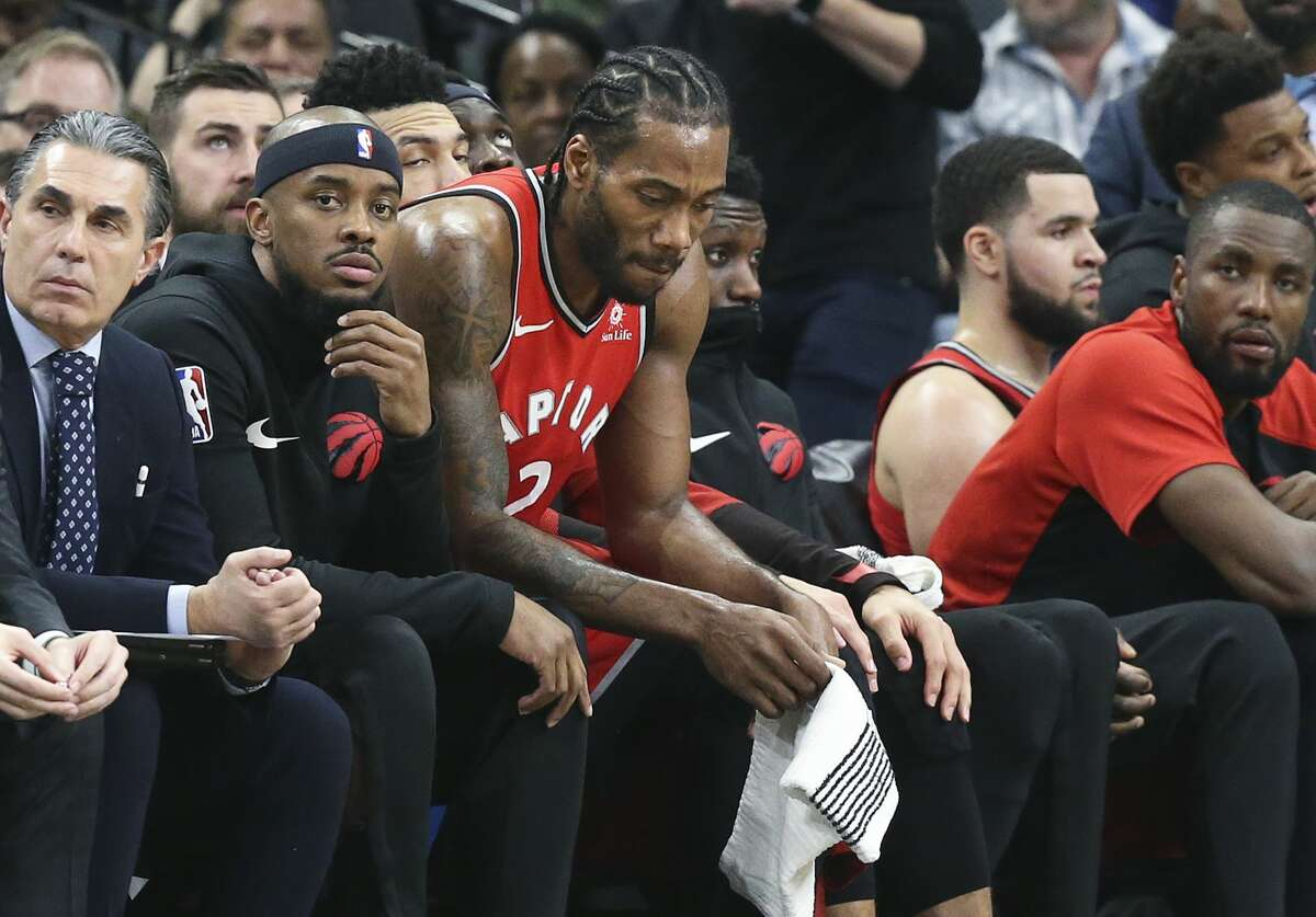 Kawhi Leonard takes the bench in the fourth quarter as the game gets out of hand for his team as the Spurs host the Raptors at the AT&T Center on January 3, 2019.