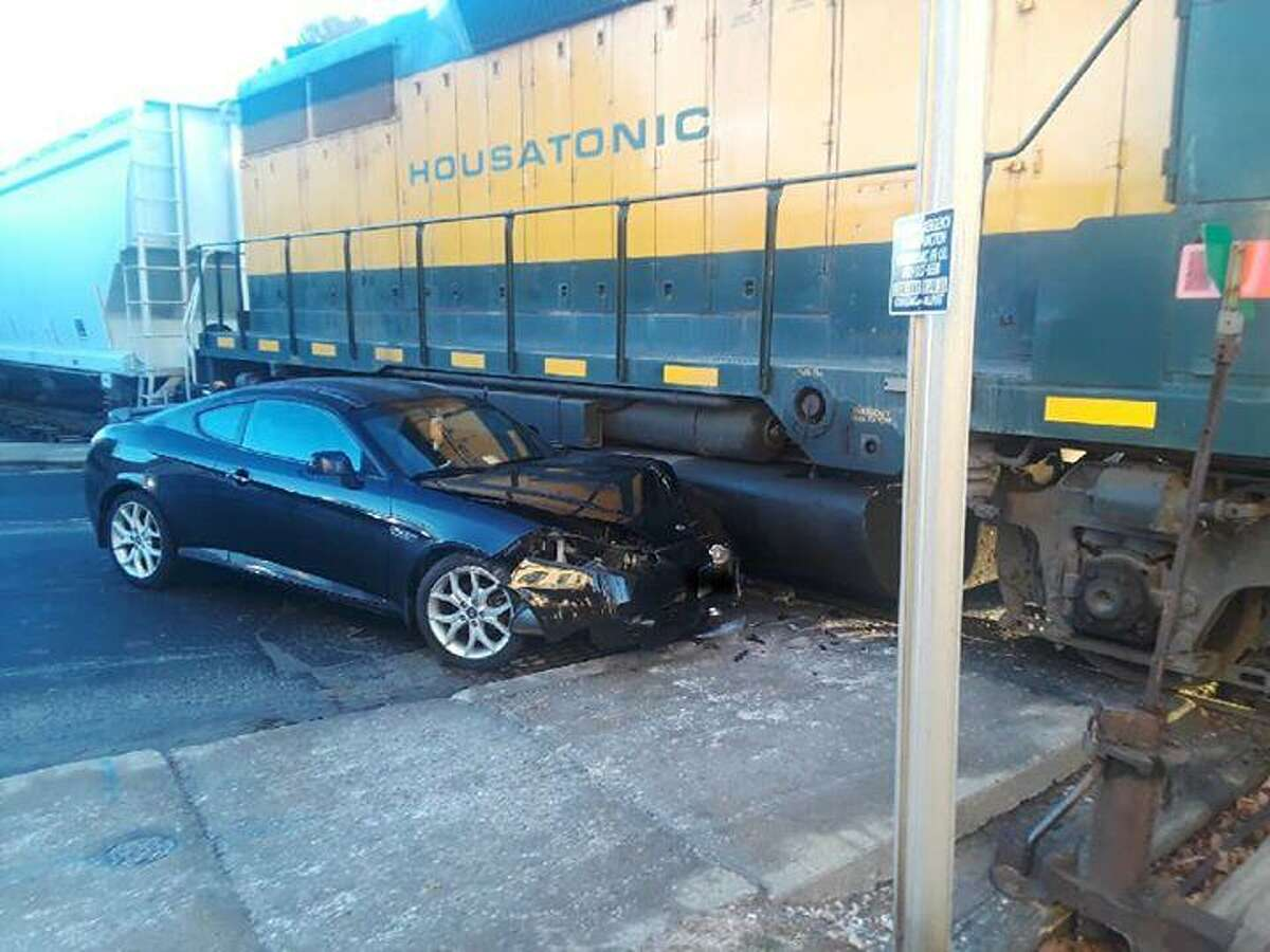 A Housatonic Railroad train sideswiped a car at a rail crossing in the upstate Connecticut town of Canaan on Friday, Jan. 4, 2019. State Police said there were no serious injuries, but it did require a detour of traffic during the AM commute.