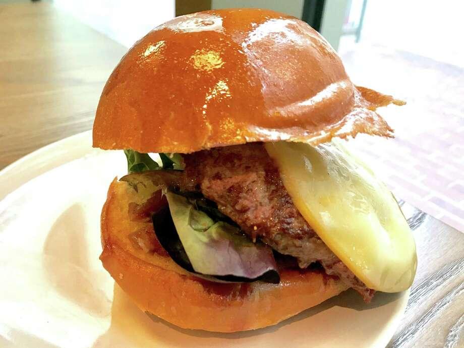 Craft Burger with smoked gouda, smoked tomato jam and mixed greens at Craft Burger at Finn Hall Photo: Alison Cook / Staff