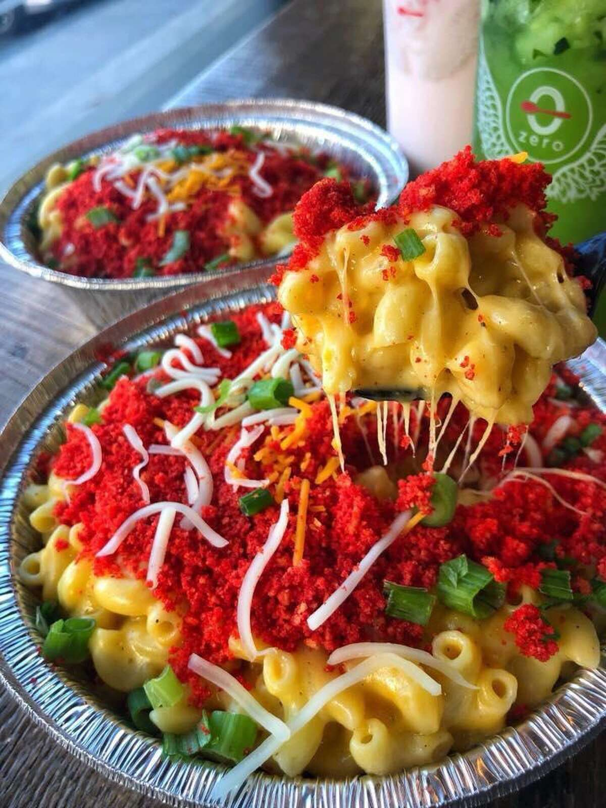 Mac N' Cheese Cheetos is made with elbow pasta, cheddar, mozzarella with XXTRA Flamin Hot Cheetos and green onions.