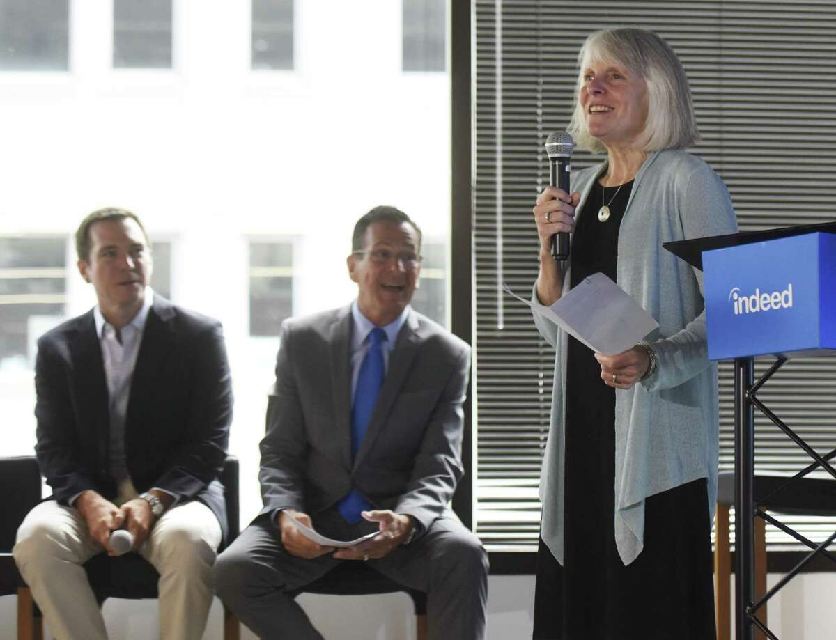 Connecticut Department of Economic and Community Development Commissioner Catherine Smith speaks beside Indeed SVP and CFO Dave O'Neill, left, and Connecticut Gov. Dannel P. Malloy at the Indeed headquarters in Stamford, Conn. Wednesday, July 12, 2017. Online job-search giant Indeed plans to create up to 500 new jobs over the next few years through tens of millions of dollars in company investment and state aid, Gov. Dannel P. Malloy and company executives announced Wednesday.