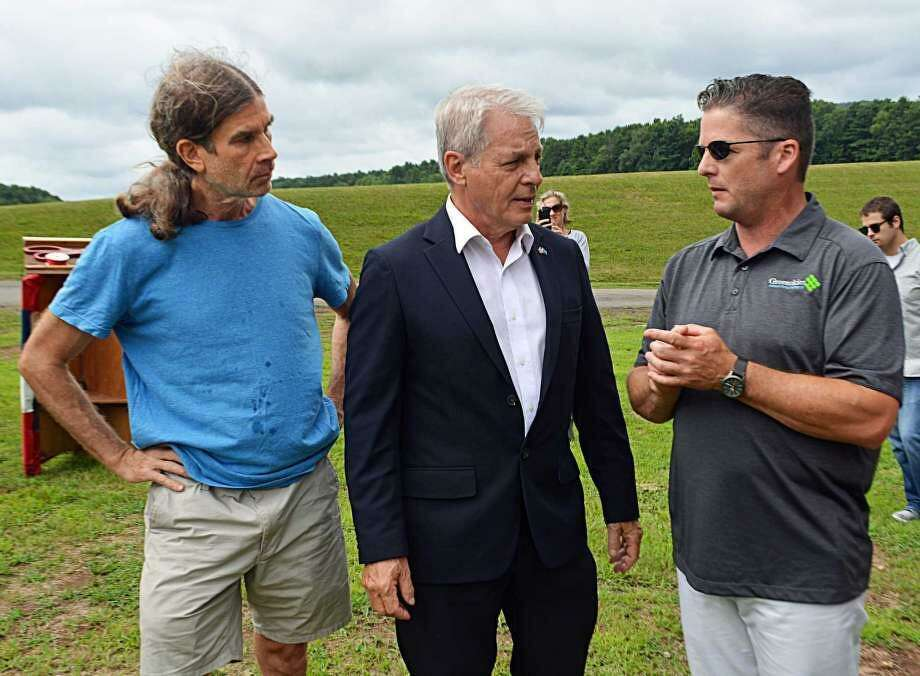 From left, Jeff Hush, member of the Middletown's Clean Energy Task Force; former state senator Len Suzio, and James Desanatos, vice president of Business Development & Government Relations at Greenskies Renewable Energy; attended the unveiling of a solar array adjacent to the Higby Water Treatment Facility in June. Photo: File Photo