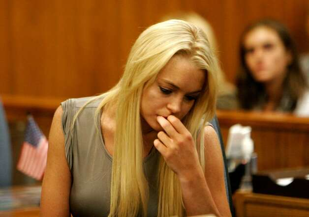 BEVERLY HILLS, CA - JULY 20:  Actress Lindsay Lohan surrenders at the Beverly Hills Courthouse to serve her 90 day jail sentence on July 20, 2010 in Beverly Hills, California. Lindsay Lohan was found in violation of her probation for the August 2007 no-contest plea to drug and alcohol charges stemming from two separate traffic accidents.  (Photo by Al Seib-Pool/Getty Images) *** Local Caption *** Lindsay Lohan Photo: Pool, Getty Images / 2010 Getty Images