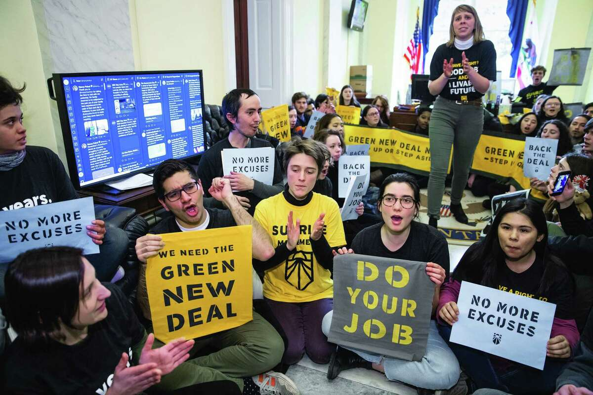 Environmental activists occupy the office of new House Speaker Nancy Pelosi last month seeking support for a Green New Deal.