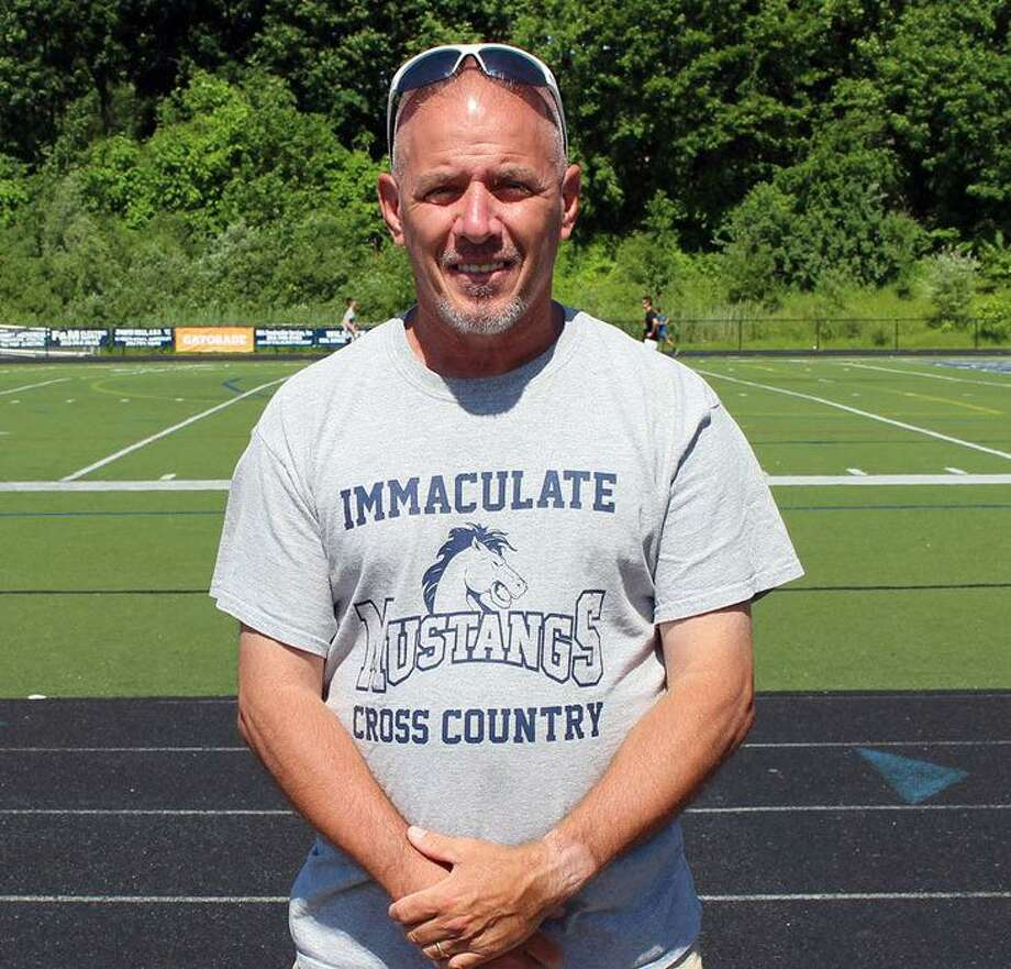 Immaculate girls cross country coach Brian Hayes was named Connecticut Coach of the Year by USA Track & Field. Photo: Contributed Photo
