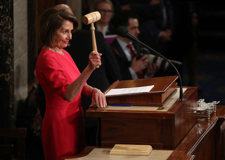 WASHINGTON, DC - JANUARY 03: Speaker of the House Nancy Pelosi (D-CA) smiles after receiving the gavel from Rep. Kevin McCarthy (R-CA) following her election as the next Speaker of the House during the first session of the 116th Congress at the U.S. Capitol January 03, 2019 in Washington, DC. Under the cloud of a partial federal government shutdown, Pelosi reclaimed her former title as speaker and her fellow Democrats took control of the House of Representatives for the second time in eight years.(Photo by Win McNamee/Getty Images