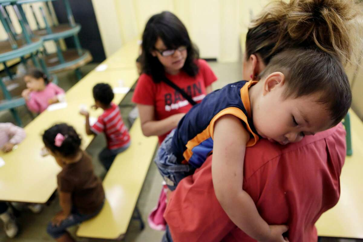 18-month-old Matias Brise�o napping on his mother's shoulder at the Jefferson Childhood Development Center in Oakland in 2010. As the new governor of California, Gavin Newsom will propose an increase of nearly $2 billion in early childhood educational spending.