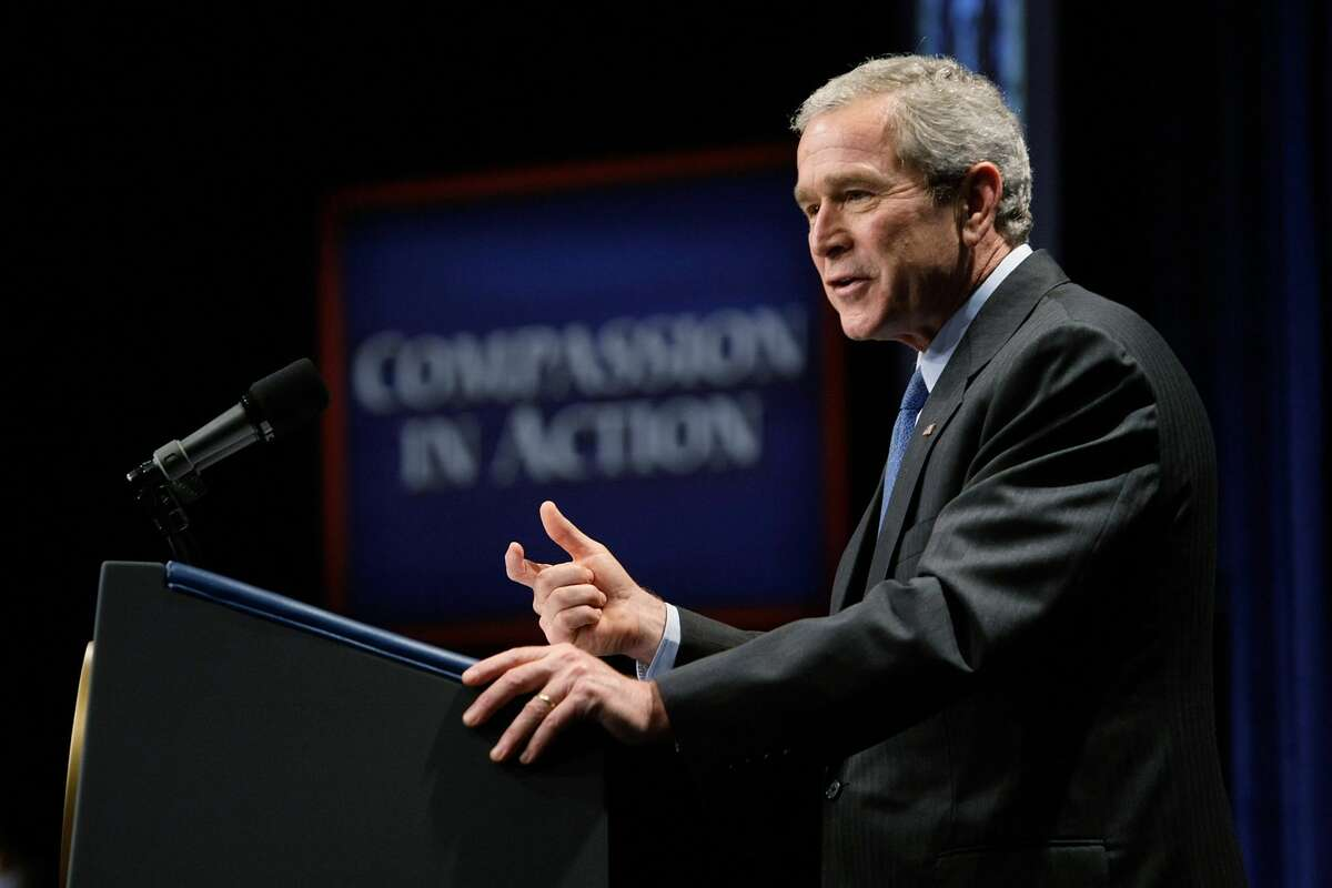 2001: U.S. President George W. Bush creates the White House Office of Faith-Based and Community Initiatives (later the Office of Faith-Based and Neighborhood Partnerships) meant to fund social service programs delivered through faith-based organizations. Major conditions of the effort are that a church or other faith-based group cannot use the money for inherently religious activities and cannot discriminate on the basis of religion in its charity efforts. A man who publicly goes by Malcolm Jarry, who would go on to establish the Satanic Temple years later with a man self-identified by his moniker Lucien Greaves, found this political move alarming. Jarry believed that if a Satanic group tried to receive such funding they would be denied. Pictured: U.S. President George W. Bush speaks during the White House Office of Faith-Based and Community Initiatives (OFBCI)