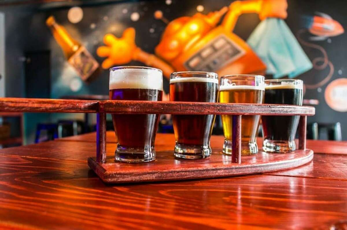 A flight of craft beers at Cosmic Brewery.