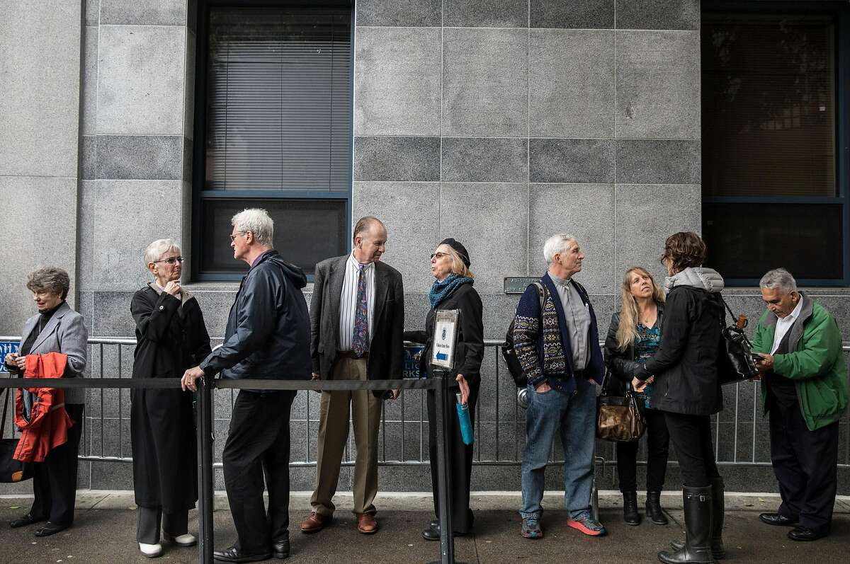 Faith-based community leaders and church members line up outside of the U.S. Citizen and Immigration Services building in San Francisco, Calif. Wednesday, Nov. 28, 2018 to support undocumented immigrants during their immigration hearings.