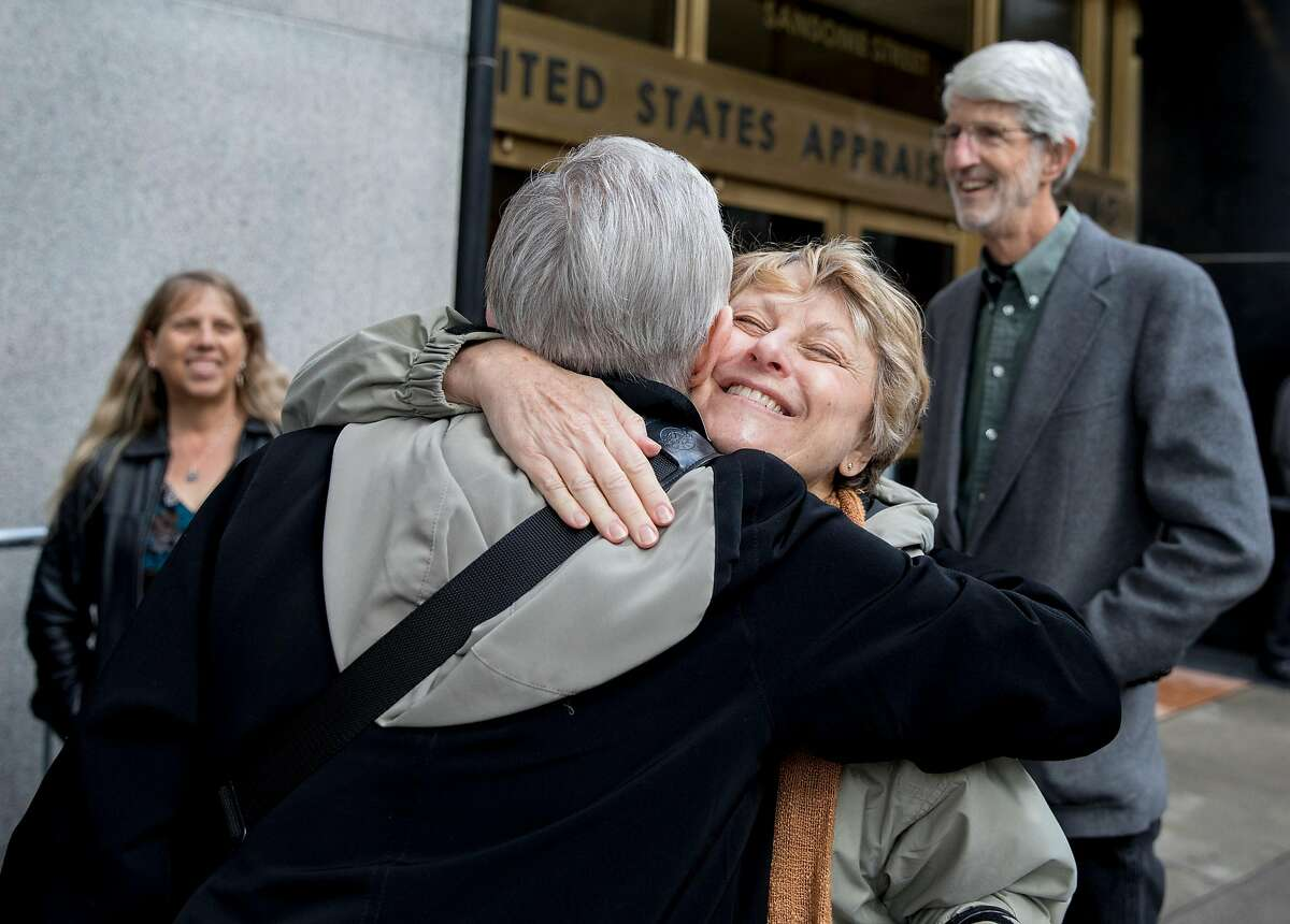 Valley Presbyterian Church Elder Anita Wotiz (right) hugs Sister Joan Marie O�Donnell outside of the U.S. Citizen and Immigration Services building in San Francisco, Calif. Wednesday, Nov. 28, 2018 before entering to support undocumented immigrants during their immigration hearings.