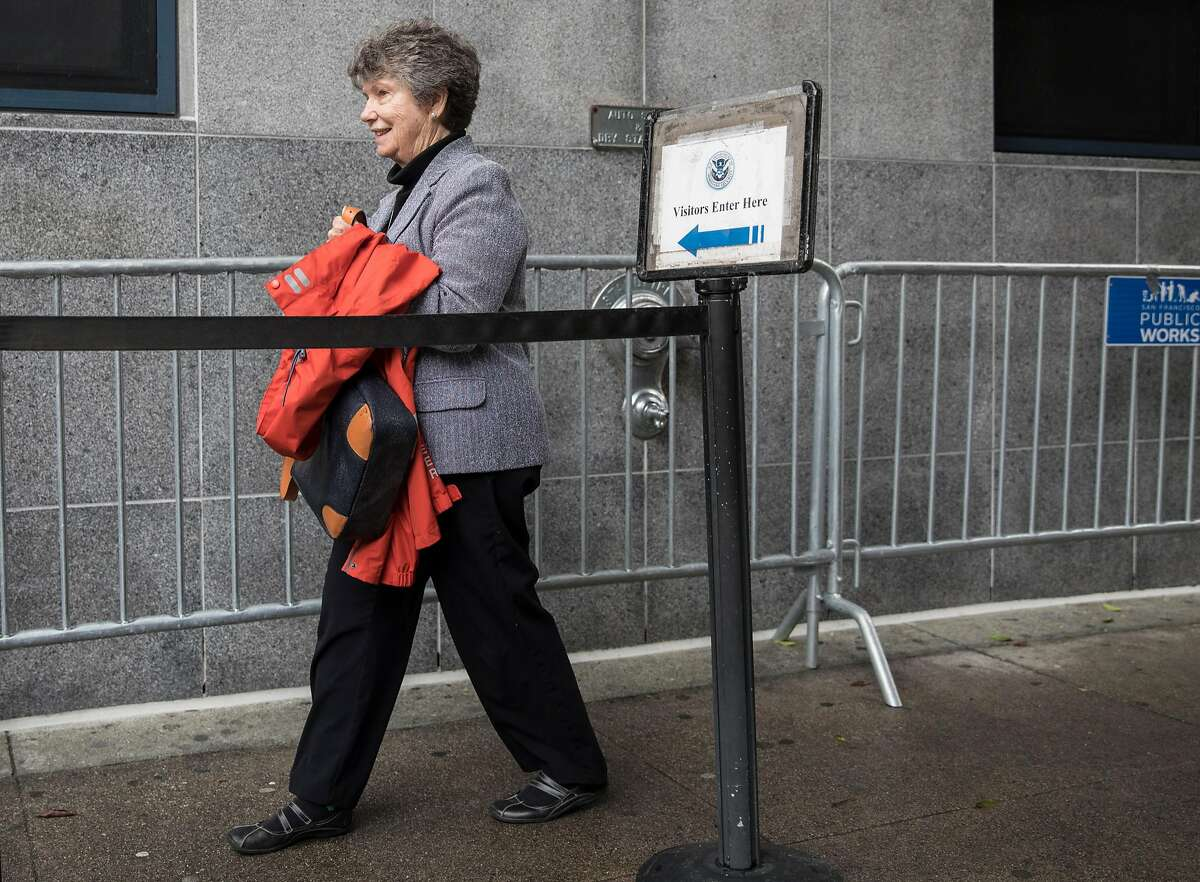 Sister Judy Carle enters the line to enter the U.S. Citizen and Immigration Services building in San Francisco, Calif. Wednesday, Nov. 28, 2018 to support undocumented immigrants during their immigration hearings.