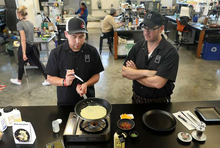 Egg cook project coordinator Michael Alvarez (left) cooks an omelette in the test kitchen at Just Inc. with VP of culinary Chris Jones (right) on Thursday, Dec. 6, 2018, in San Francisco, Calif.