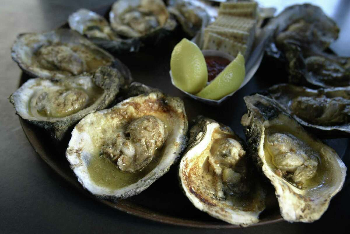 Oysters are roasted with garlic butter and parmesan at Gilhooley's in San Leon.