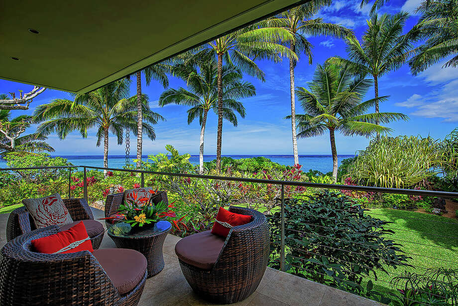 "Kirstin Hannah, author of the bestsellers ""The Nightingale"" and ""The Great Alone,"" has listed her longtime home in Kauai for $10.75 million. The oceanfront contemporary features two offset wings that are both oriented toward the sea. A dining lanai and other patios create additional living space outdoors. (Dave Tonnes-Panaviz/TNS) Photo: Dave Tonnes-Panaviz / Los Angeles Times"