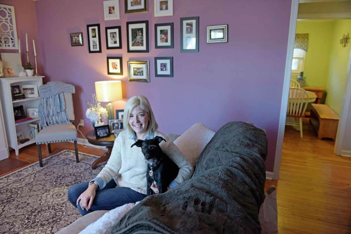 Becky Daniels with her dog Izzie inside her home on Sumner Avenue on Wednesday, Jan. 2, 2019, in Schenectady, N.Y. (Paul Buckowski/Times Union)