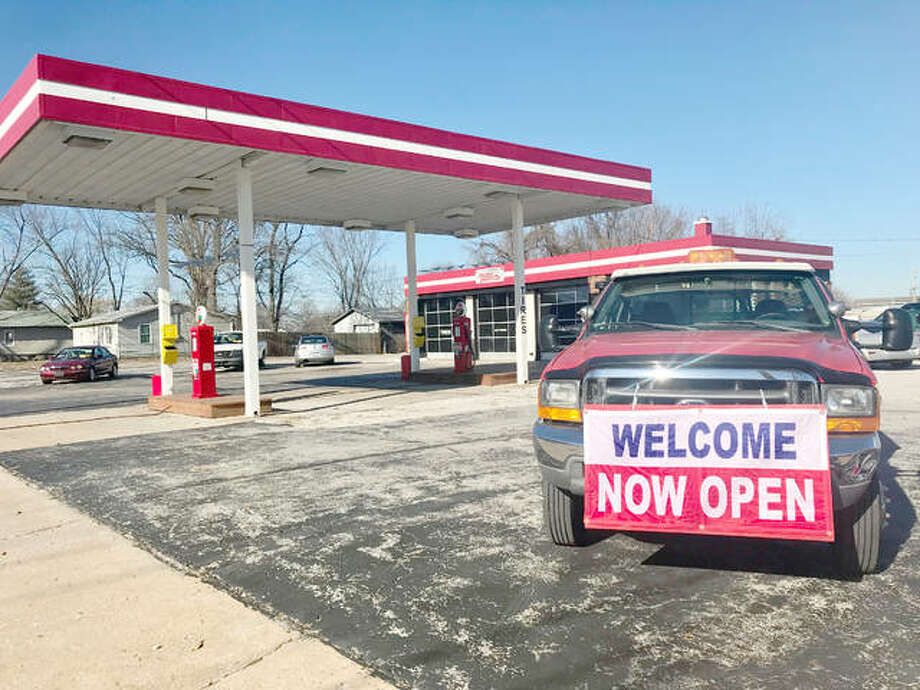 """Truck parked outside of Milton Motors new storefront reads, """"Welcome, Now Open."""" Photo: Riley Newton 