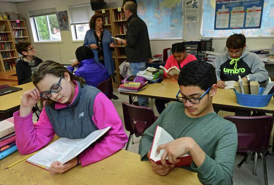 Side by Side Charter School 8th graders Grace Galeano and Sam Aguilar read during their humanities class Friday, April 7, 2017, at the school in Norwalk, Conn. The School is celebrating its 20th anniversary and has announced construction plans for a new school building to house their middle school students. Photo: Erik Trautmann / Hearst Connecticut Media / Norwalk Hour