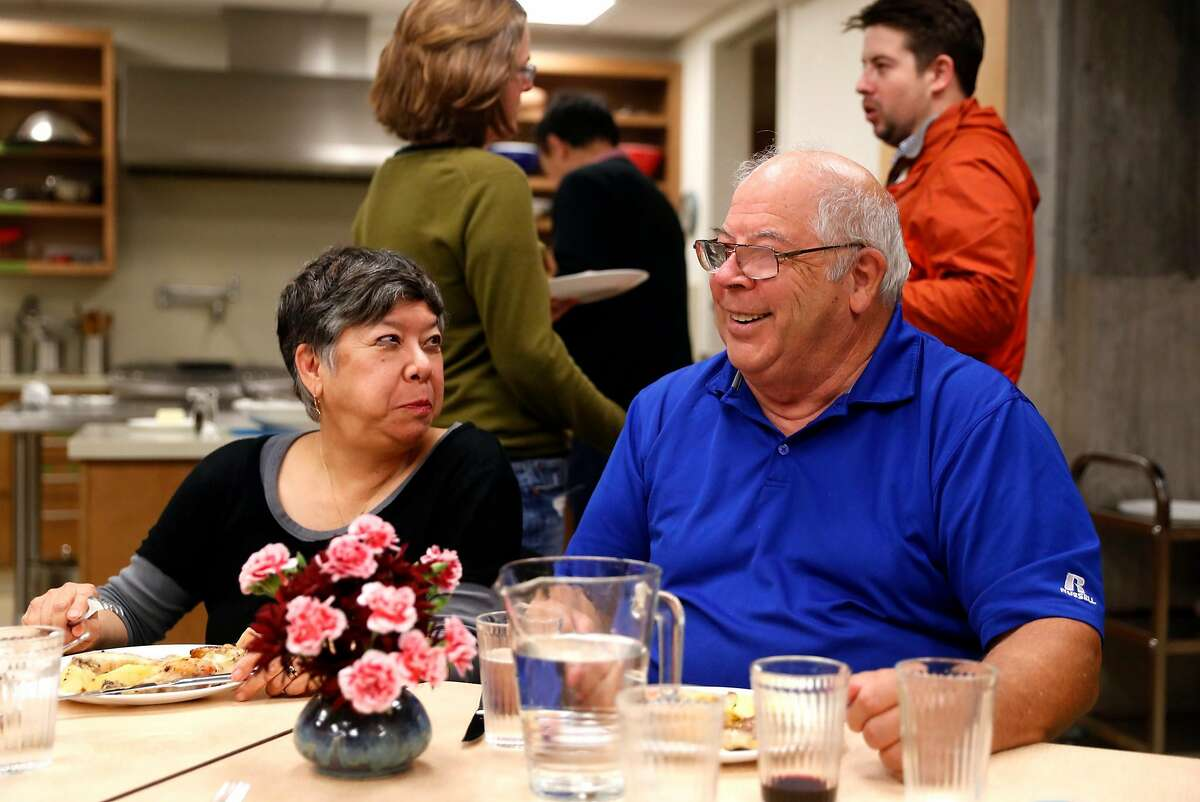 Chris Zimmerman and Leslie Watson-Hollinsead enjoy a group dinner at Phoenix Commons in Oakland, Calif. on Wednesday, December 5, 2018.