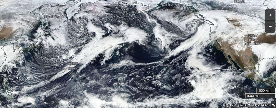 This NASA satellite image taken Thursday shows weather systems forming over the Pacific Ocean and heading toward California. Photo: NASA