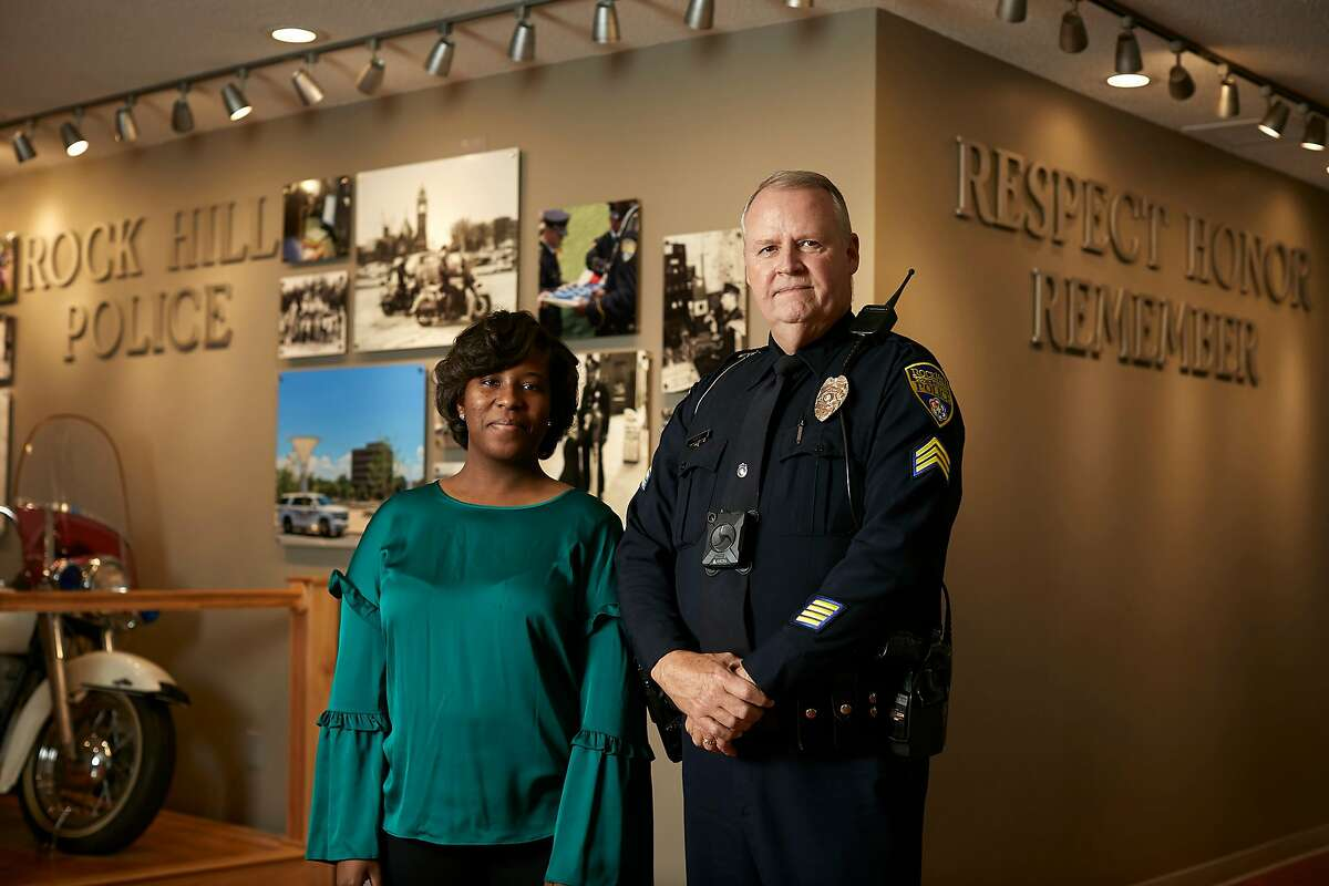 Courtney Davis, a telecommunications operator at the Police Department in Rock Hill, S.C., and Rock Hill police Sgt. Bruce Haire, in Rock Hill, S.C., Dec. 17, 2018. Facebook called Davis about a man who was live-streaming a suicide attempt, helping Haire find him. Some doctors warn that Facebook is becoming an arbiter of users' mental distress without proving that its efforts are accurate, effective or safe. (Logan R. Cyrus/The New York Times)