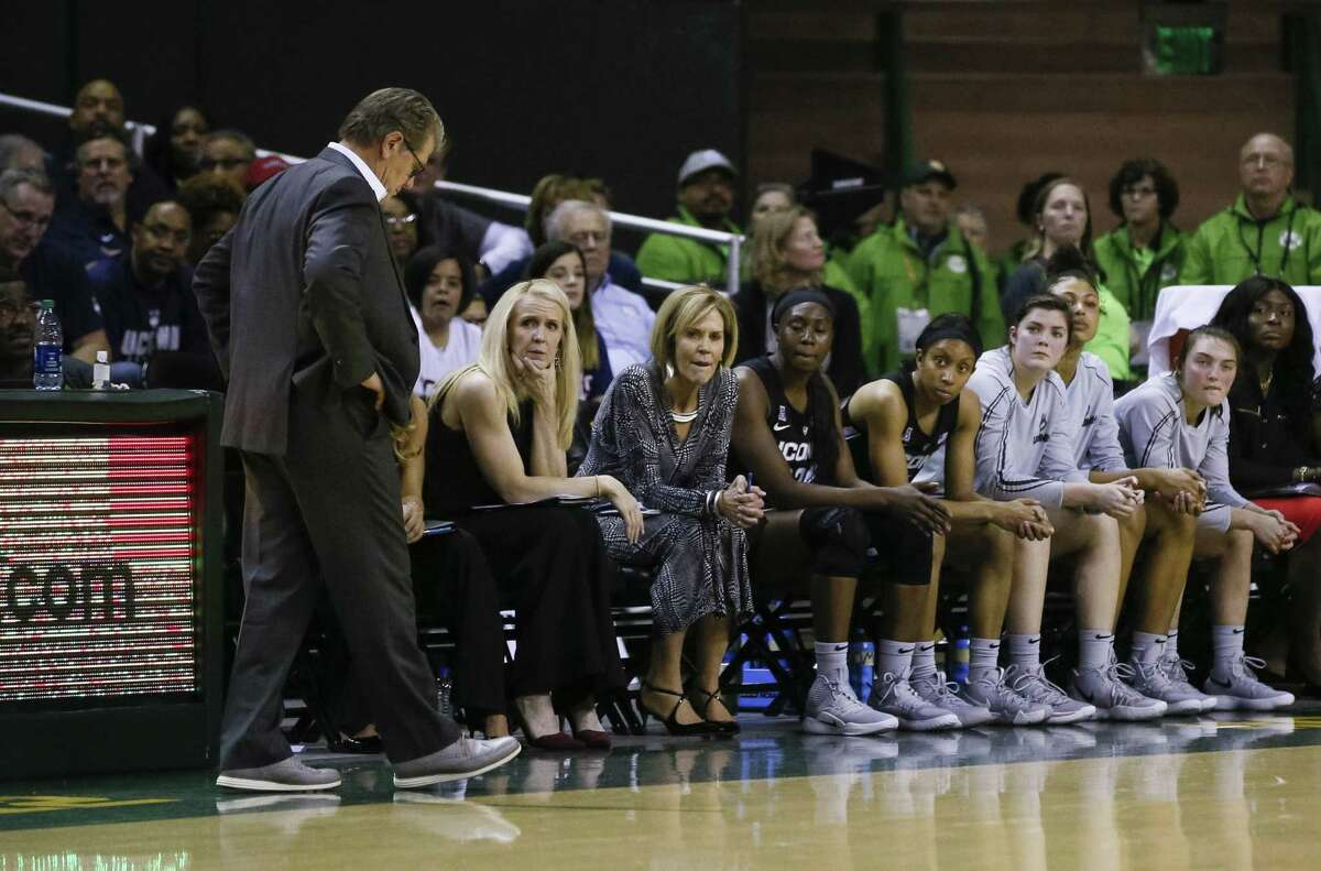 Head coach Geno Auriemma and the UConn bench look on in the closing seconds of a loss to Baylor Thursday night in Waco, Texas.
