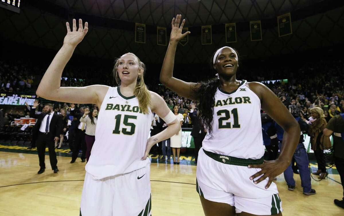 Baylor forward Lauren Cox (15) and center Kalani Brown (21) stand during the playing of the school fight song following the team's 68-57 victory over No. 1 UConn Thursday night in Waco, Texas.