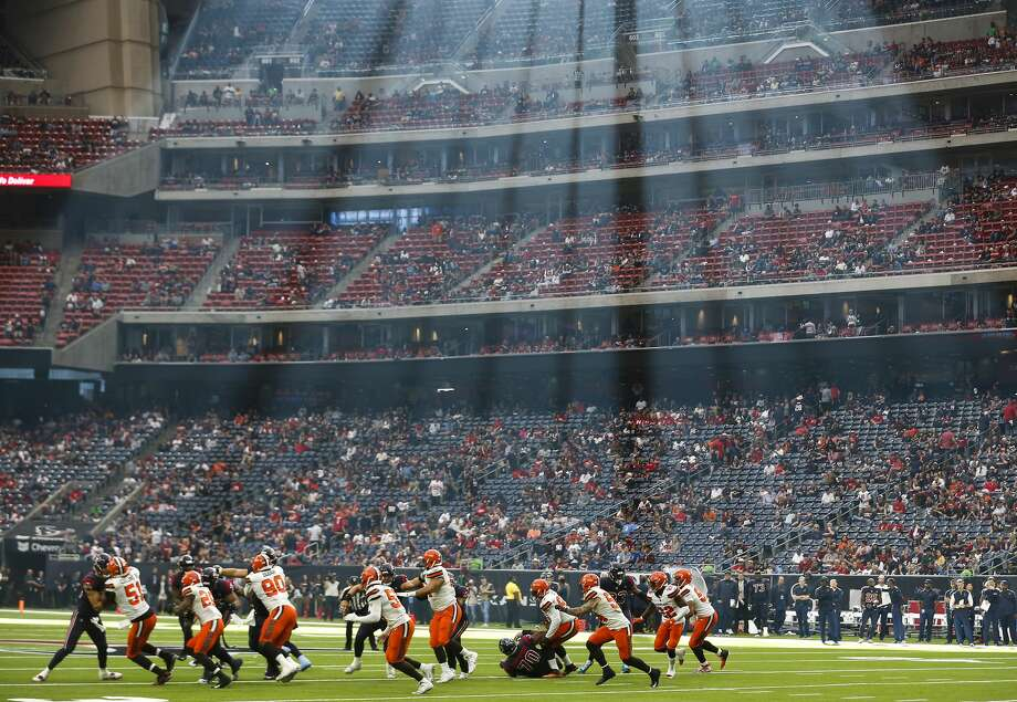 The Houston Texans run a play under a stream of sunlight against the Cleveland Browns during the fourth quarter of an NFL football game at NRG Stadium on Sunday, Dec. 2, 2018, in Houston. Photo: Brett Coomer/Staff Photographer