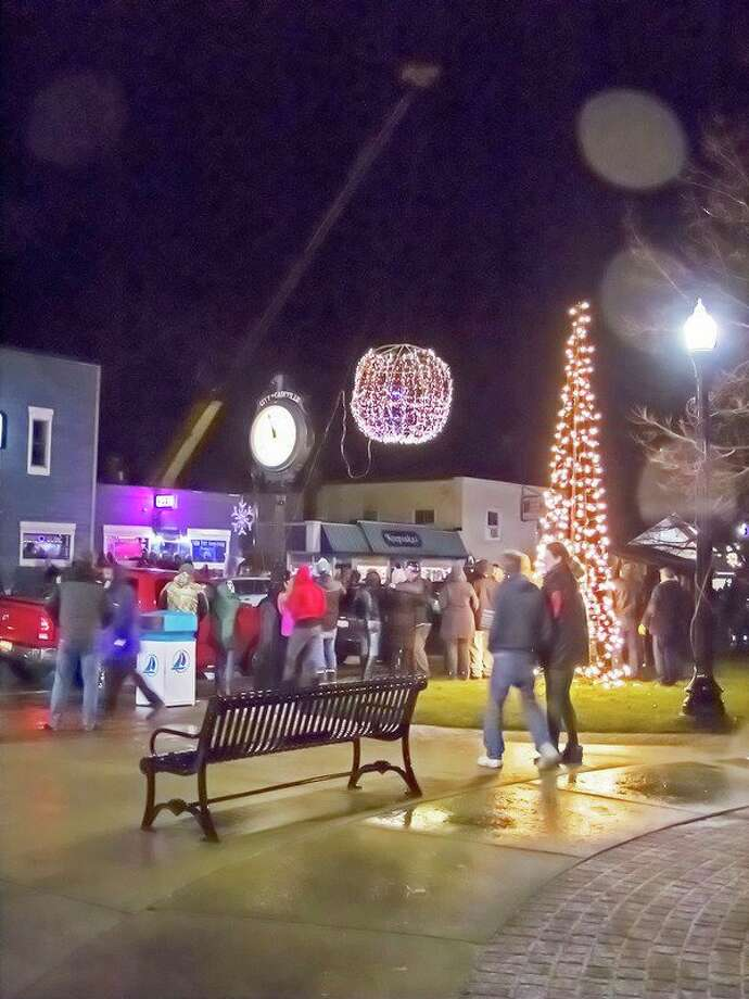 More than a hundred people gathered in downtown Caseville to welcome in 2019 by watching the lighted ball drop in front of the Blue Water Inn. There was some added excitement when the ball briefly caught fire. It didn't dampen anyone's enthusiasm, however, and the fire basically went out on its own. (Bill Diller/For the Tribune)
