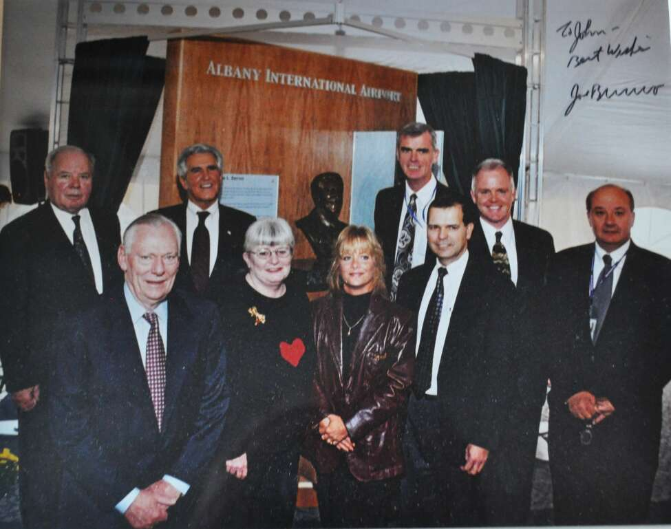 Left to right: Airport Authority CEO John Egan, Southwest Airlines co-founder and CEO Herb Kelleher, Senate Majority Leader Joseph L. Bruno, Southwest Corporate Secretary Colleen Barrett, Albany County Airport Authority Administrative Assistant Ginger Olthoff, Chief Financial Officer Dwight Hadley, Chief Operating Officer John O'Donnell, Airport Authority Counsel Peter Stuto, and airport spokesman Doug Myers.