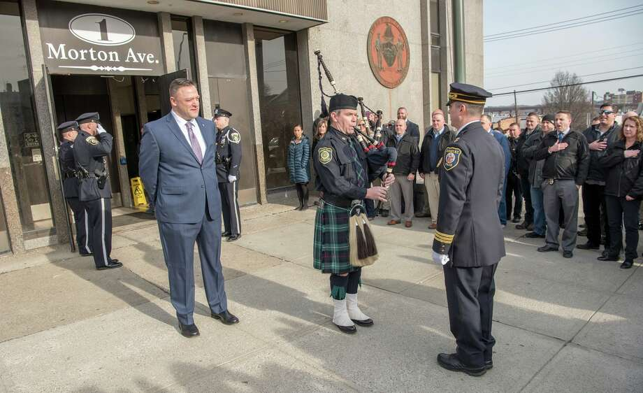 Albany Police Detective James Olsen stands outside South Station for a tradition piping out ceremony to mark his retirement on Jan. 4, 2018, in Albany, N.Y. Photo: Albany Police